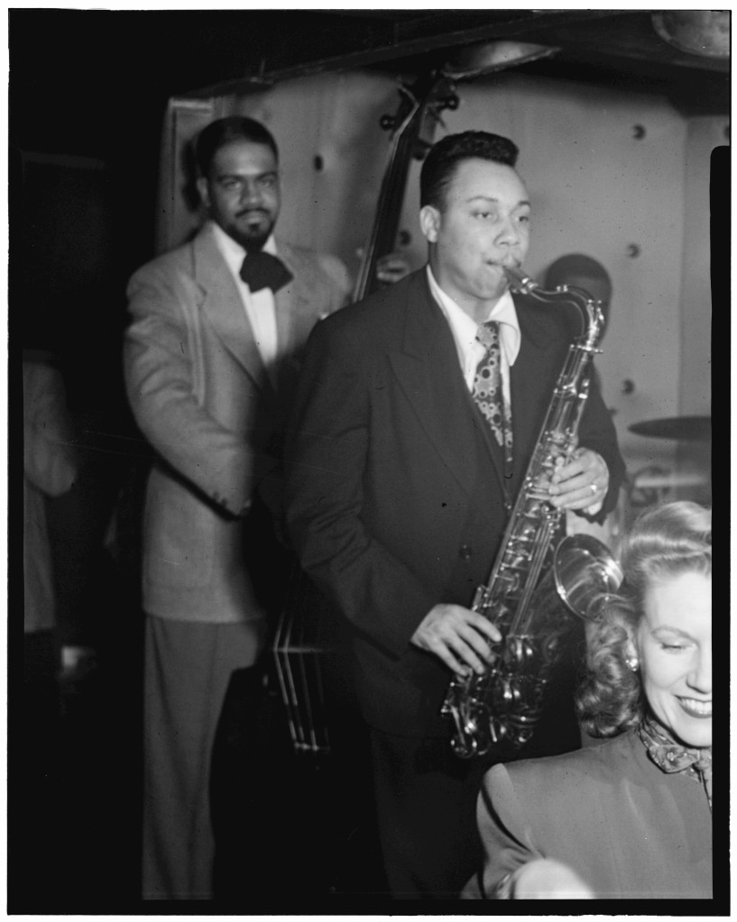 "Downbeat caption, July 1948: ""Swing was born on Fifty-second Street. Devotees still go there for hot music. Here, at the Three Deuces, Hilda Taylor and a friend enjoy the Lucky Thompson orchestra. A former Miss North Carolina, she is now a professional singer."" That's Al McKibbon on bass."