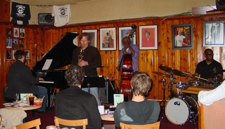 The old fashioned jazz joint..tables, burgers, drinks, fans and a killer band. That's Chuck Manning on tenor and the Charlie O's house trio of bassist John Heard, drummer Roy McCurdy and pianist Andy Langham.  Three sets, no cover, two drink minimum.