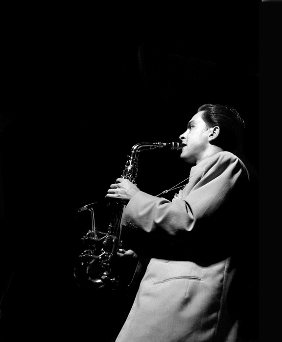 Art Pepper (taking his turn with Stan Kenton, Balboa, CA. 1950) I wish I knew who took this perfect jazz photo.