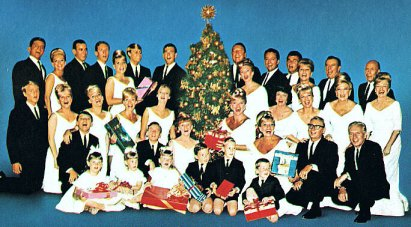 Thirty six of the thirty seven members of the King Family. Where's Grandma? Behind the tree?