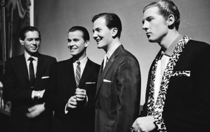 Dick Clark, Pat Boone and Jerry Lee Lewis, who is thinking about kickign both their asses right there on live TV.