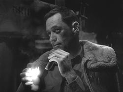 William Holden's bruised face, Stalag 17.