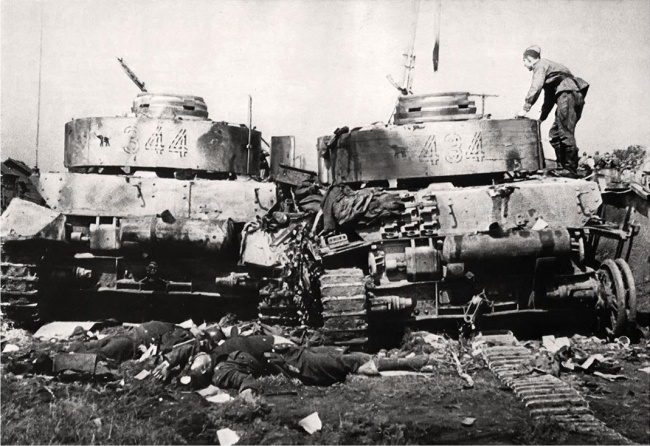 Geman Panzers IVs with crews in a vision of unimaginable violence.