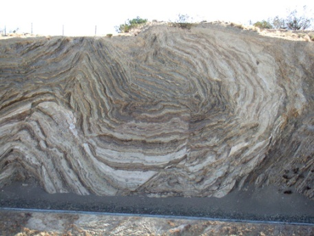 The San Andreas Fault...dig the layers there. They were originally laid down horizontal and quite flat. Now they've been compressed and rolled into a strudel. How much time are we seeing there, a million years? More?