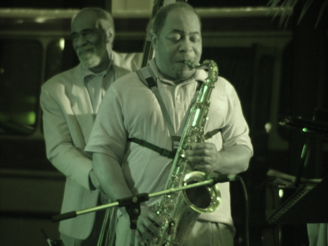 Herman Riley, with John Heard on the bass.