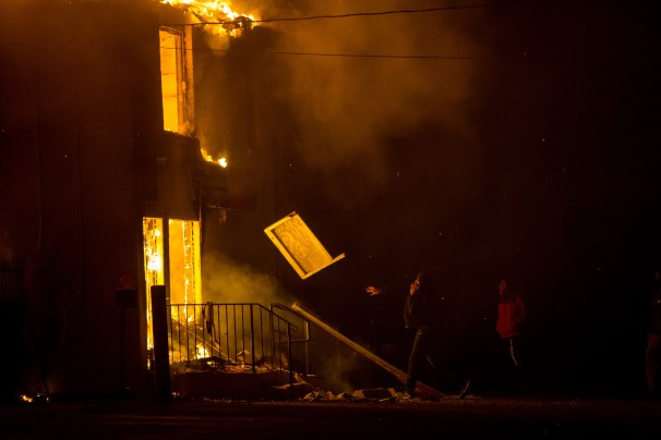 A public storage facility consumed in flames in Ferguson, Missouri, November 24, 2014.