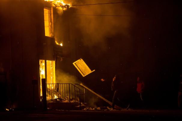 A public storage facility consumed in flames in Ferguson, Missouri, November 24, 2014.