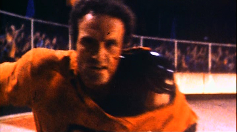 James Caan in the real Rollerball (1975), which was set in 2018, actually.