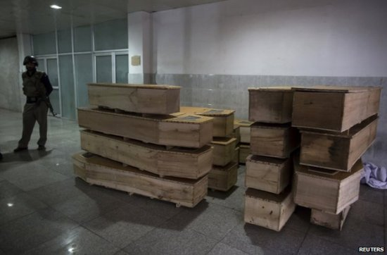 Coffins stacked in readiness at a Peshawar hospital as casualties were brought in. (Photo from Reuters, no idea who took the shot.)