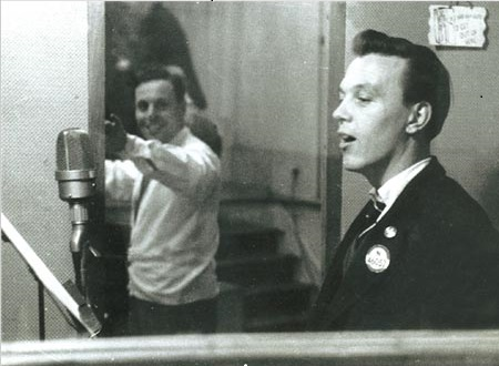 A very young Matt Monro, no idea who's conducting the orchestra outside the booth. I'm assuming it's a London studio. Copped this from mattmonro.com.