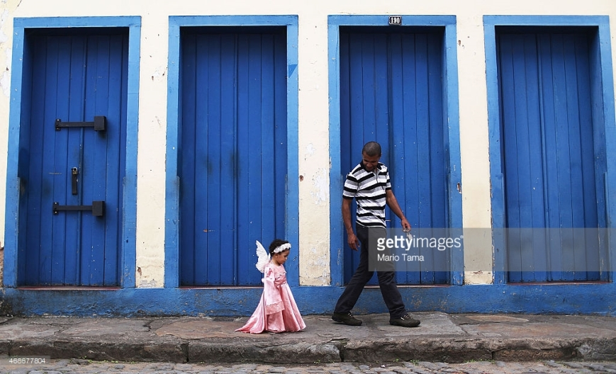 OURO PRETO, BRAZIL - APRIL 05: A girl dressed as an angel walks home after marching in the annual Easter procession during traditional Semana Santa (Holy Week) festivities on April 5, 2015 in Ouro Preto, Brazil. Holy Week marks Easter celebrations for Catholics and Brazil holds the largest number of Catholics on the planet. Ouro Preto was a colonial mining town founded in the late 17th century and the Semana Santa tradition in Ouro Preto can be traced back to the 18th century Portuguese colonial period. (Photo by Mario Tama/Getty Images)