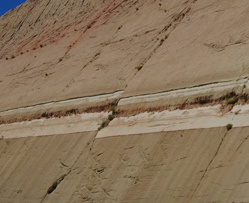 A roadcut on the I-40 outside Kingman AZ, with a layers of sediments as horizontal as when they were deposited being split in two by a young fault. Come back in a few million years see what it looks like.