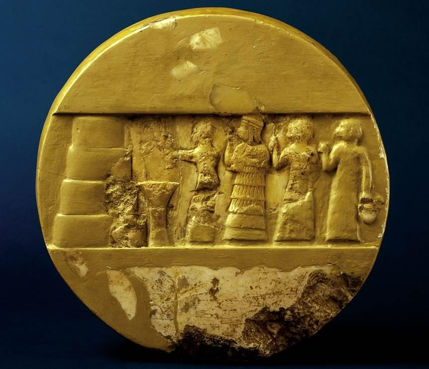 A votive disc of Edheduanna, carved in her lifetime. She is at center.