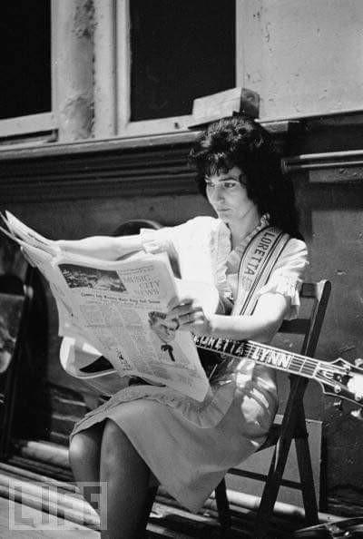Loretta Lynn reading the paper